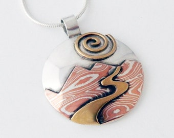 Mixed metal jewelry, mokume gane pendant, silver, brass Mountain River mixed metal pendant