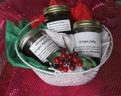 Basket of preserves with grape jelly, ginger apple butter & bluebarb jam