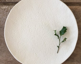 Large creamy white plate with textured surface, 11'' diameter