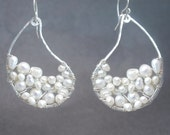 Hammered drops wrapped with ivory pearls Cosmopolitan 49