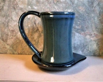 Blue Mug with attached Saucer