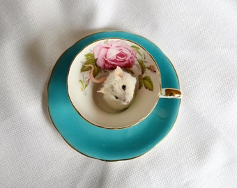 Taxidermy mouse in tea cup.