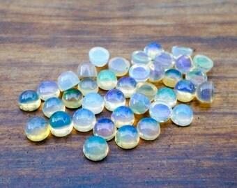 3mm ethiopian opal smooth cabochon. glowing radiant gemstone flashy opal cabs round gems