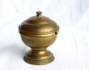 Vintage brass sugar bowl with a hinged lid.