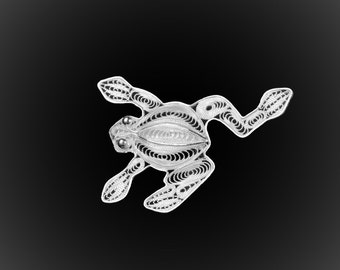 Embroidered with silver frog brooch