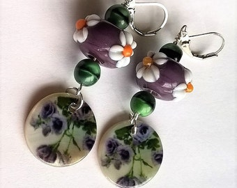 Adorable Lever Back Earrings: Purple Flower Printed Mother of Pearl Disk, Purple and White Flower Lampwork Glass Beads, Green Glass Beads