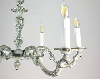 Brass light fixture, chandelier. Shabby chic lighting. Light green-gray chandelier.