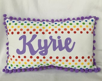 Pillow in rainbow polka dots and name in purple