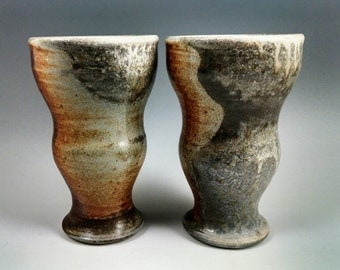 Two wood-fired tumblers/cups.