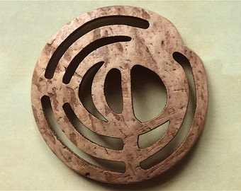 Cocoanut button, a wonderfull design in cut cocoanut shell.