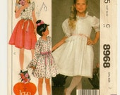 "A Pullover, Scoop Neckline, Front Buttoned Dress with Sleeve, Trim & Peplum Variations: Girls Size 7, Breast 26"" • McCall's 8968"