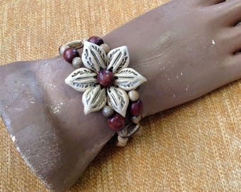 Wide cuff bracelet natural seed pods wooden wood beads beaded bold flower shape adjustable hippie bohemian boho chic tribal costume jewelry
