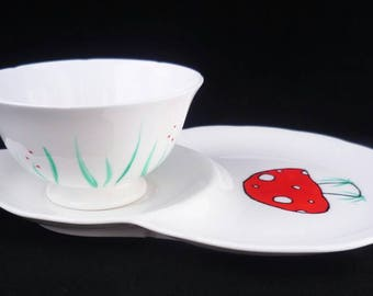 Toadstool and flowers tea cup and saucer/biscuit plate.