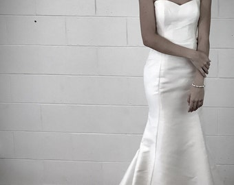 Simple silk minimalist wedding dress fit and flare mermaid style for unique beach weddings