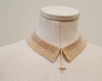 "1950's Vintage Beaded Pearl Collar with cream satin backing  1"" wide by 16"" in length   1 hook for closure"