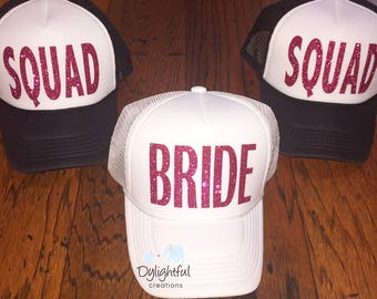Bride squad black and white trucker hats with pink glitter
