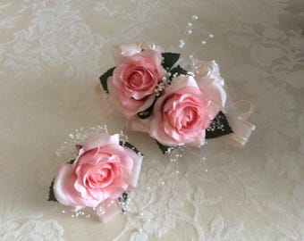 Pink rose corsage with matching boutonniere