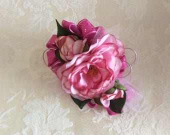 Corsage and matching boutonniere in pink camellias