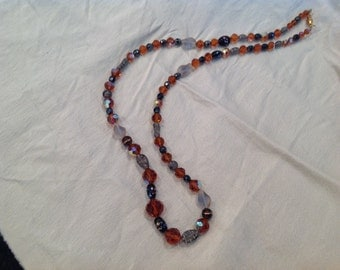 Necklace, burnt orange crystals plus shades of grey beads