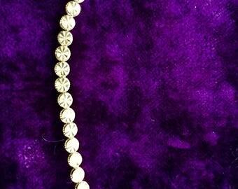 14 karat gold bracelet in etched pattern OR in heart mark,circa 1980