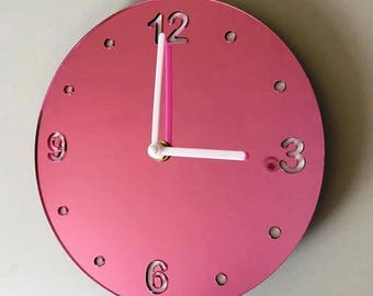 "Round Pink Mirror & White Clock - White Acrylic Back, Pink Mirror Finish Acrylic with White hands, Silent Sweep Movement.  Sizes 8"" or 12"""