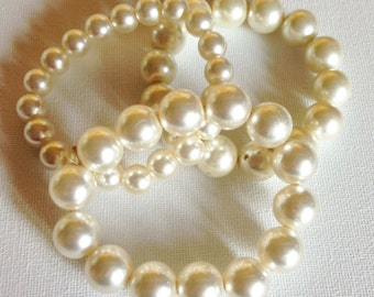 Bracelets  - trio of pretty pearly cream plastic beaded bracelets retro design