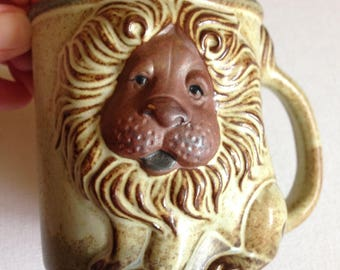 Pottery lion mug in perfect condition