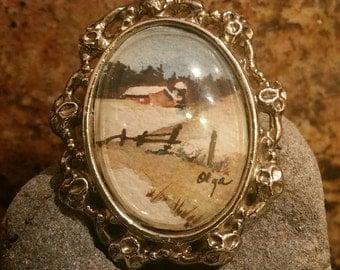 Vintage miniature watercolor painting in a locket