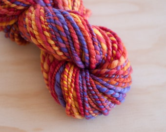 Handspun soft superfine merino yarn / Brilliant reds oranges yellows and violet / Bulky - Chunky weight handspun soft merino yarn
