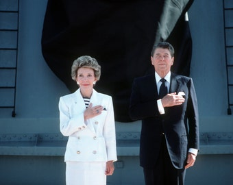 Ronald Reagan and Nancy Reagan salute the American Flag, Photograph