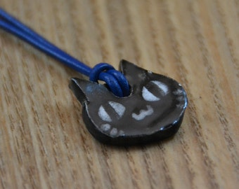 Black Cat Ceramic Medaillon on a Leather Necklace