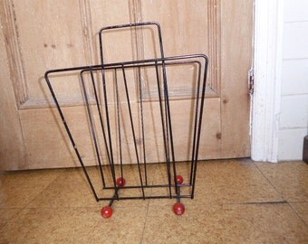 Vintage original 1950s black wire magazine rack with red atomic ball feet