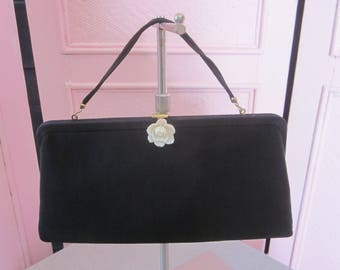 """1960s Black Faille Evening Clutch with White Rose by """"HL, USA."""""""