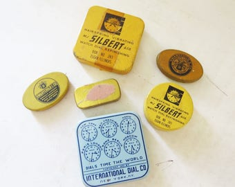 6 small vintage metal tin boxes- watch part boxes- advertising boxes -