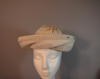 Ivory wool hat embellished with beads and sequins