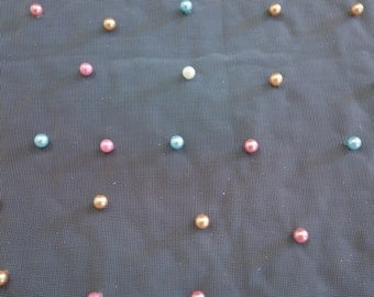 Cream tulle pearl studded fabric
