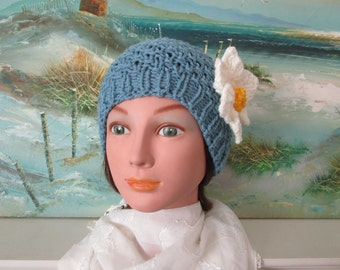 Unique knitted blue ladies spring hat with flower pin.