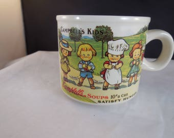 Campbells soup cup with a replica design from 1910 of the Campbells kids.