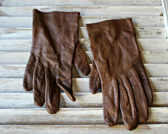 Vintage. Brown. leather. gloves. 1960s. Nice gloves! Size 7. 100% silk lining. Made in Philippines.