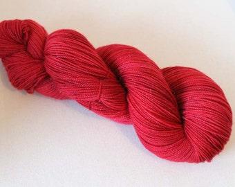Semisolid red, Hand dyed Glitter Sock yarn, 75/20/5 sw merino / nylon / silver stellina