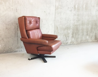 Danish 1970's mid century dark brown leather 3 cushion swivel arm chair