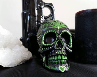 Hand painted day of the dead skull candle green