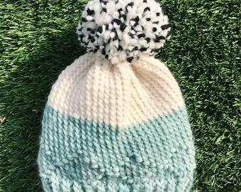 Handmade soft blue hat with pom pom