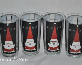 Set of 4 Vintage Atomic Santa Claus Glasses - Black, Red, and White