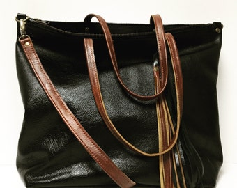 Black and brown leather tote bag with cross body strap