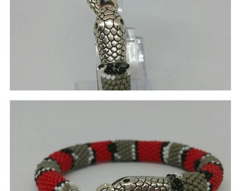 "Red wristband ""Snake""."