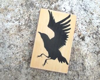 black silhouette crow in flight, bird folk art , original painting