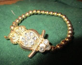 "vintage stretch goldtone bead bangle with sparkling owl 6.5""long"