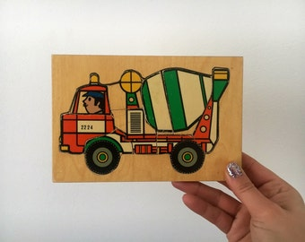Vintage wooden jigsaw puzzle game Cement truck