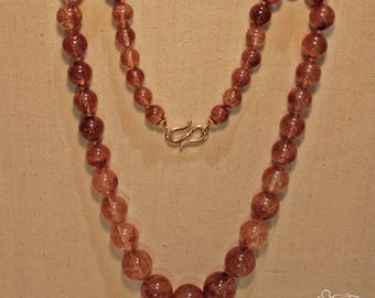 Necklace with rutilated quartz beads and rose gold hook